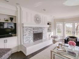 stone fireplace living room with floor to ceiling light grey