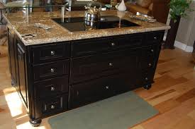 transitional style kitchen with cherry brown cabinets and black