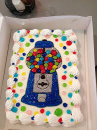 ice cream cake decorated with a blue gumball machine any dairy