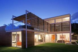 open roof deck with stylish clear glass balcony railing design for