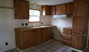 how to paint particle board cabinets painting mobile home cabinets a new look for your cabinets