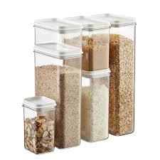 set of narrow stackable canisters with white lids the container
