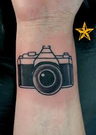 funny and original black and white old camera tattoo on hand