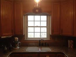 cabinet trim kitchen sink should i remove the wood that s between the cabinets above