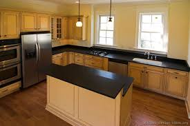 Kitchen Colors With Oak Cabinets And Black Countertops The Two Level Island Is What We U0027re Thinking But With The Overhang
