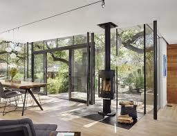 Outdoor Glass Room - modern cottage extension with exterior terraces by nick deaver