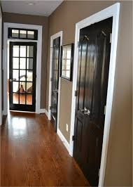 black doors white edge wood floors with that on the