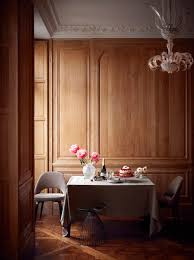 oak wood panelled dining room in elegant paris apartment with