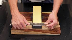 sharpening kitchen knives with a stone how to sharpen a knife using a sharpening stone youtube