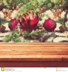 christmas background with empty wooden deck table over christmas