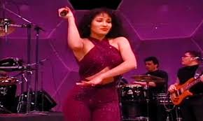 selena quintanilla purple jumpsuit the is asking for a selena doll with an