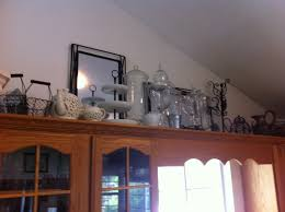 Decorating Ideas For Above Kitchen Cabinets Ideas To Decorate Above Kitchen Cabinets Amys Office
