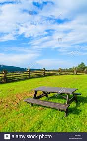 wooden picnic table on green field in a village near arlamow stock