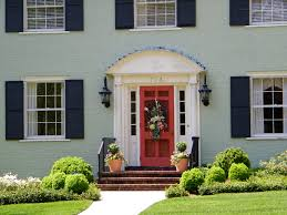 painted brick exterior in green with a red door u2013 flowergardengirl