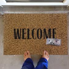 Geek Doormat A Welcoming Prank 50 Dollar Bill Welcome Doormat Ohgizmo