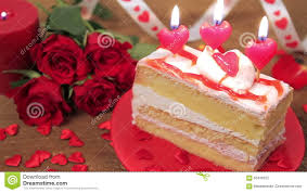 decorated cake with candles and roses on wood stock footage