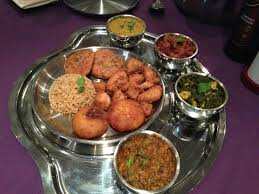 cuisine a 4 mains large thali 3 starters 4 mains rice and 2 chapatis on the side