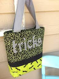 tricks and treats halloween tote bags