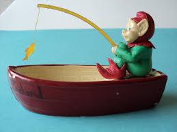 irish leprechaun fishing in a boat souvenir of old ireland cute