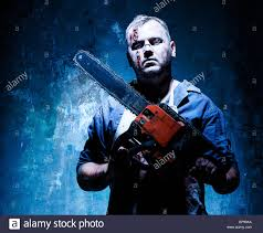 bloody halloween theme crazy killer as butcher with electric saw