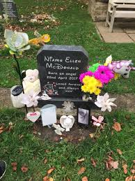 family disgusted after cemetery staff remove decorations from baby s