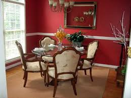 red walls with white border and classy furniture for elegant