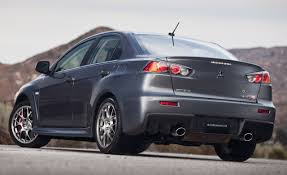 evo spoiler 2010 mitsubishi lancer evolution gets revised interior new
