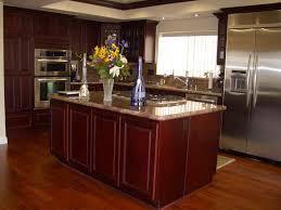 cherry kitchen cabinets black granite