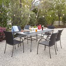 Outdoor Metal Dining Chairs Ludwig 7 Piece Outdoor Dining Set With Stacking Wicker Chairs
