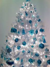 a crispy white tree with blue ornaments new year