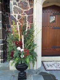 winter planter garden design birch poles spruce tips incense