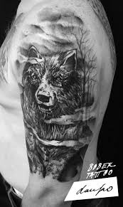 black ink wolf on left half sleeve