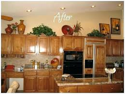 how to decorate top of kitchen cabinets top of kitchen cabinet decor musicyou co