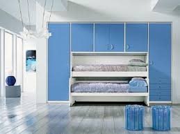 sea themed room ideas with mural design and bed canopy beach white bedroom interior with stained wooden canopy bed and bunk integrated blue solid wood closet organizer