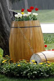 wood barrel garden planter