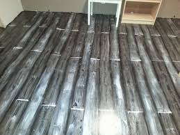 Concrete Floor Sweeping Compound by Painted Concrete Floor Looks Like Wood Planks For The Home