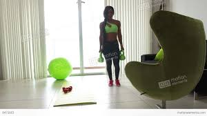 7 home fitness black woman training legs with weights stock video