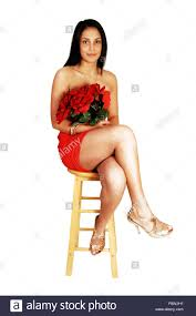 High Sitting Chair A Pretty Teenager In A Red Strapless Dress And Gold High