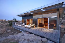 simple home design with iron fence and transparent roof modern