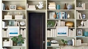 Bookcase With Baskets 12 Creative Ways To Decorate With Shells Coastal Living
