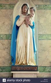 holy statue of the virgin mary holding the baby jesus in saint