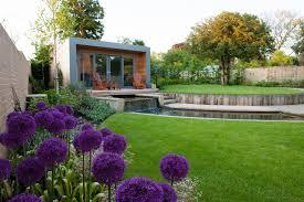 impressive backyard design with white concrete tiles flooring of