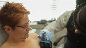 the u0027michelangelo u0027 of tattoos helps breast cancer survivors