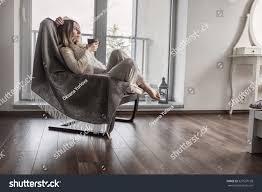 woman drinks coffee relax on vintage stock photo 527507128 woman drinks coffee and relax on vintage sofa at home near the window interior decoration