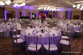 white and silver table runner white table cloth accented with royal blue runners and silver chairs