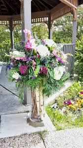 wedding flowers calgary ceremony jewl toned flowers on birch log filled vase dahlia