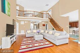 contemporary living room with balcony hardwood floors in