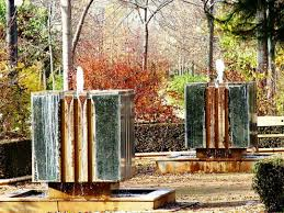 fountains for home decor outdoor unique water fountains for gardens with green trees and
