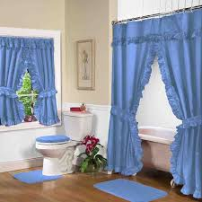 blue bathroom window curtains with freestanding bathtub and framed