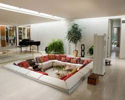 feng shui living room with sunken seat and wood metal elements